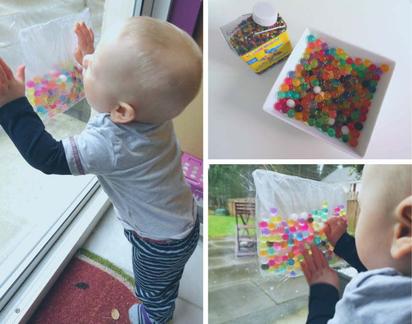 Baby playing with water beads taped inside bag