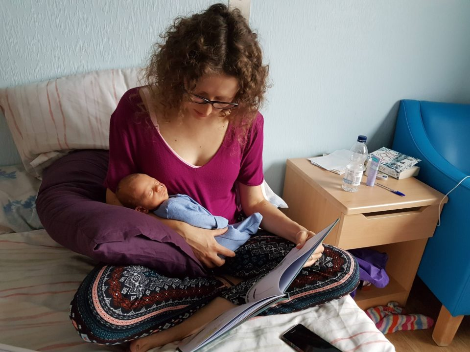 Mum reading story to baby