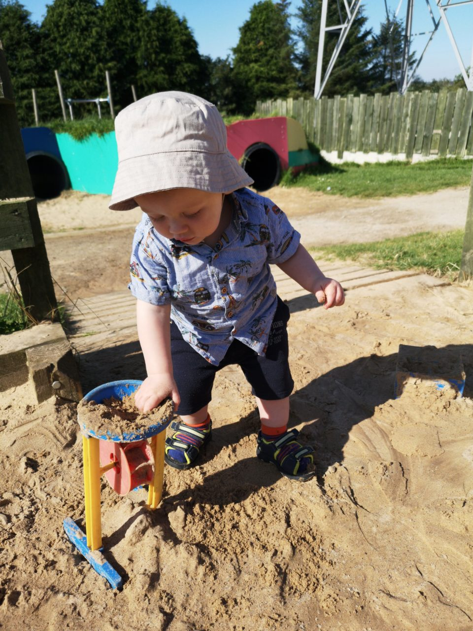 Toddler in a sand pit