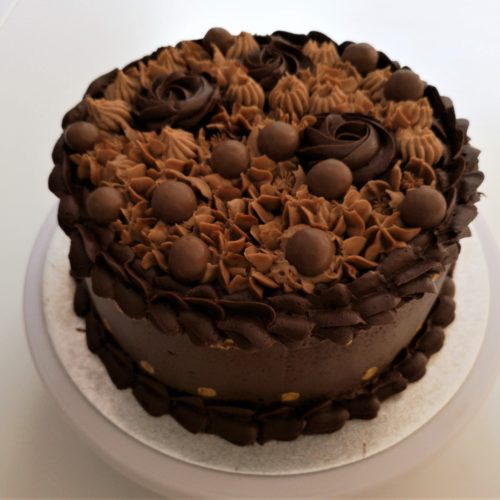 Chocolate cake with flowers piped on top