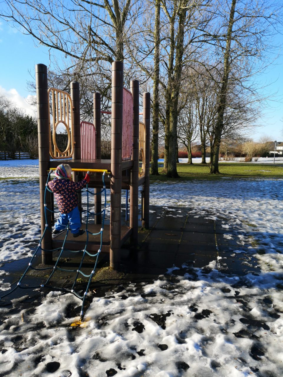 Toddler on a climbing frame at the park
